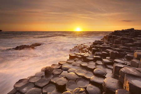 Sunset over the basalt rock formations of Giants Causeway on the north coast of Northern Ireland.