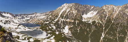 Five Lakes Valley in the Polish Tatra Mountains in spring, with the last snow still lingering on the mountains.