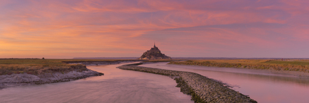 Le Mont Saint Michel in Normandy, France photographed at sunset.