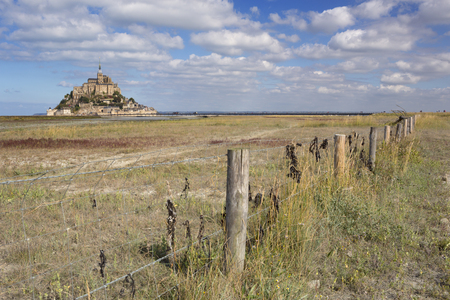Le Mont Saint Michel in Normandy, France on a sunny day.