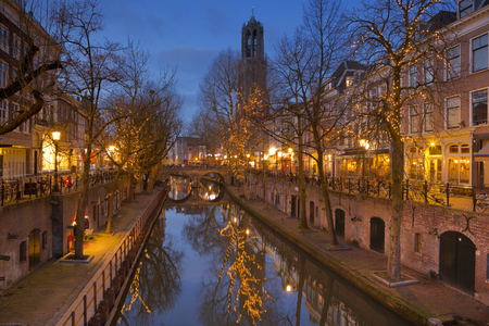 The Oudegracht canal and Dom church in Utrecht in The Netherlands at night. Reklamní fotografie