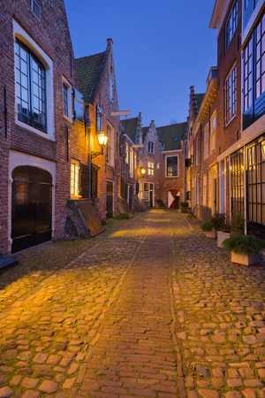 The historic alley of Kuiperspoort in Middelburg, The Netherlands at night.