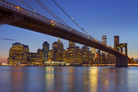 Brooklyn Bridge with the New York City skyline in the background, photographed at dusk.