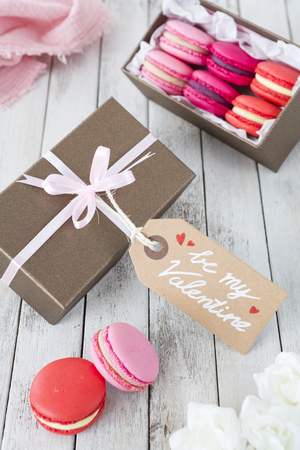 A collection of pink macarons in a gift box for Valentines Day. Reklamní fotografie