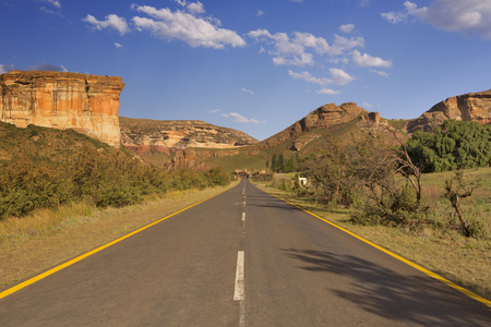 A road along the Brandwag Buttress in the Golden Gate Highlands National Park, South Africa. Photographed in late afternoon sunlight. Reklamní fotografie