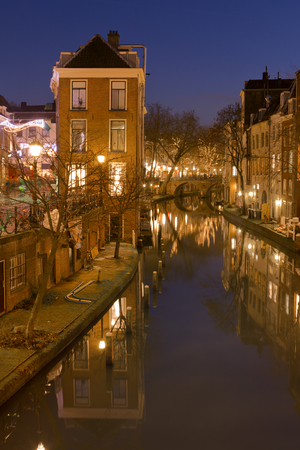 The Oudegracht canal in Utrecht in The Netherlands at night.