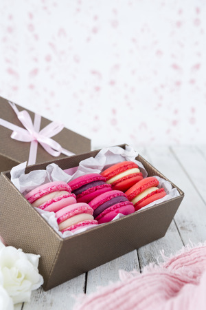 A collection of pink macarons in a gift box. Reklamní fotografie