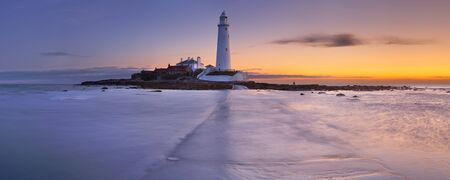 High tide coming in at the causeway towards St. Mary's Lighthouse, Whitley Bay, England. Photographed at sunrise.