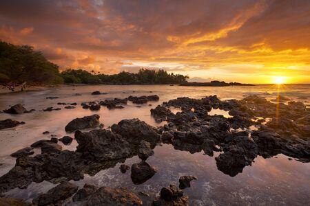 Spectacular sunset at Waialea Beach or Beach 69 on the Kohala Coast of Big Island Hawaii, USA.