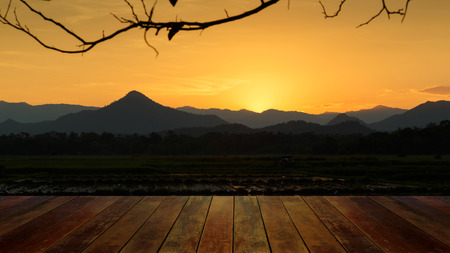 agriculturalist: beautiful sunset at mountain and wood floor in thailand Stock Photo