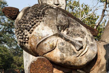Ruins Buddha statue, pagoda, monastery in ancient temple, Kampangphet historical park,Thailand. photo
