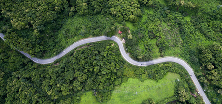 Top view of countryside and the road in Thailand. Stock Photo