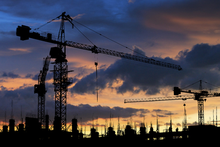 silhouette of construction site crane Stock Photo