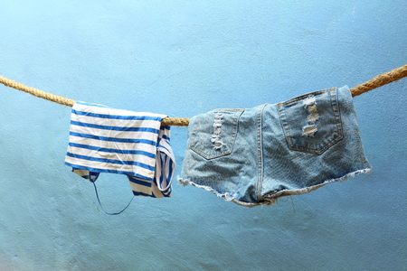 wet clothes: Wet clothes hanging on rope