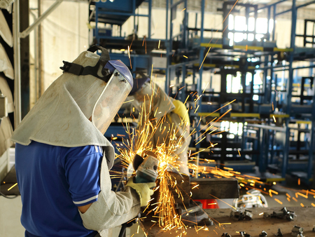 shop for: Worker grinding steel in work shop for maintenance in factory