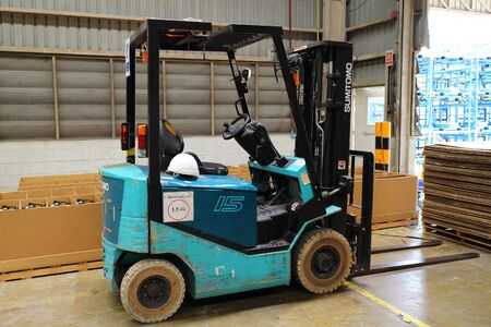 lift truck: Rayong - Thailand , MAY 18 - 2016 : Lift truck in factory warehouse , lift boxes delivery to customer
