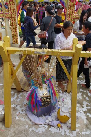 Udorn Thani - Thailand , January 01 - 2017 : Buddhist come to the temple for merit in a New Years Day and hope to good luck in life , Thai culture in Thailand. Editorial