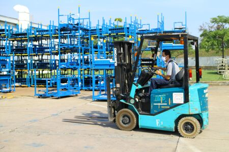 truck driver: Rayong Thailand , FEBRUARY 27 - 2017 : Lift truck working in factory for moving matrial and goods