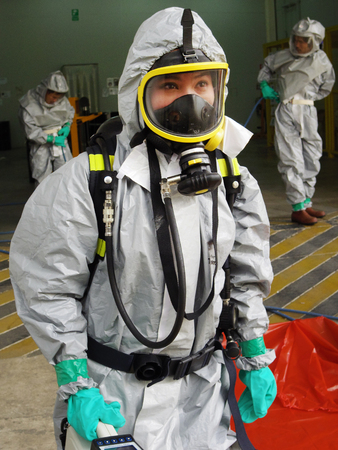 Rayong Thailand , February 09 - 2018 : Emergency team wearing chemical protection suit for work in dangerous chemical in factory. Redactioneel