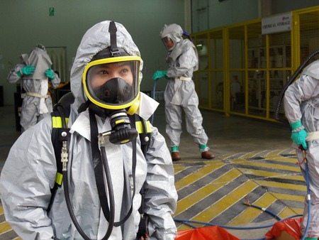 Rayong Thailand , February 09 - 2018 : Emergency team wearing chemical protection suit for work in dangerous chemical in factory. Editoriali