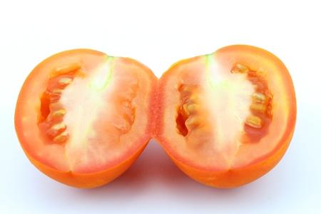Red tomato fresh vegetable on white background Stock Photo