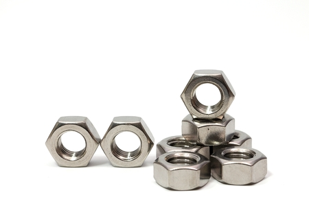 Steel nut for industrial assembly work isolated white background 免版税图像