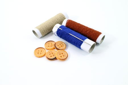 colorful button needle thread and fabric.