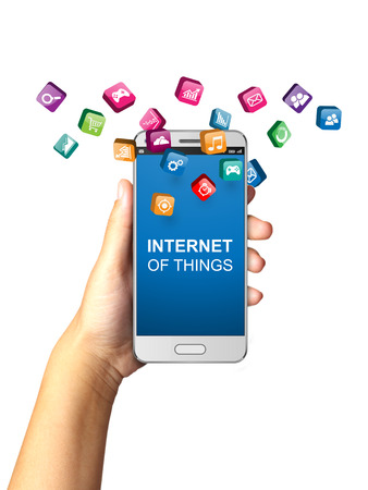 phone message: Hand holding smart phone with Internet of Things concept