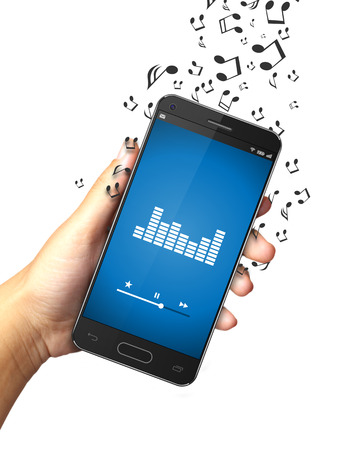 letras musicales: Hand holding smart phone with music notes Foto de archivo