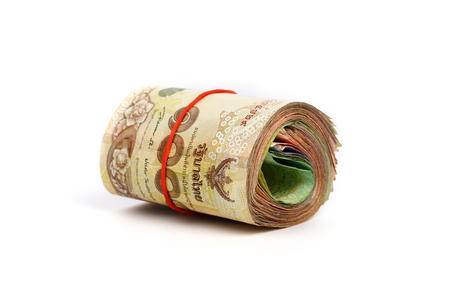 money roll: Roll of Thai money banknotes on white background