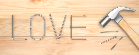 metalwork: Hammer with love letter made of metal nails on wood table, top view, panoramic banner Stock Photo