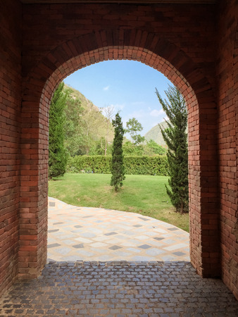 Brown archway brick with mountain background