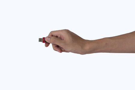 Flash drive in man hand isolated on white background Stock Photo