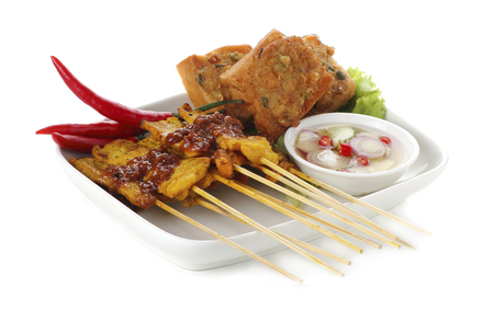 satay sauce: Grilled pork satay with sauce on plate Stock Photo