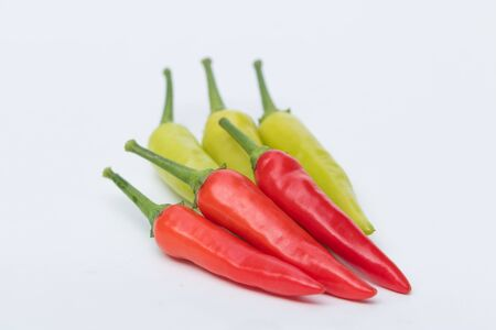 capsaicin: Close up green and red chili pepper on white background isolated. Stock Photo