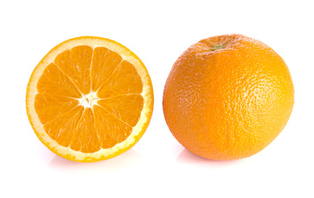 cleave: Orange cut half and full balls on white background.