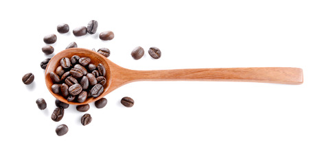 woden: Roasted coffee in woden spoon placed on white background.