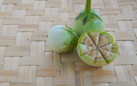 weave ball: Eggplant full ball,cut half placed on weave bamboo. Stock Photo
