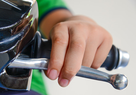 hand jamming: Hand was pressing on Clutch lever and Brake lever motorcycle.