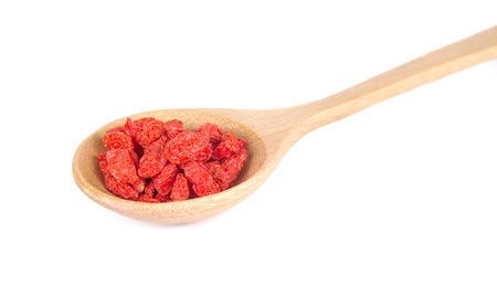 Goji Berry in Wooden spoon isolated on white background.