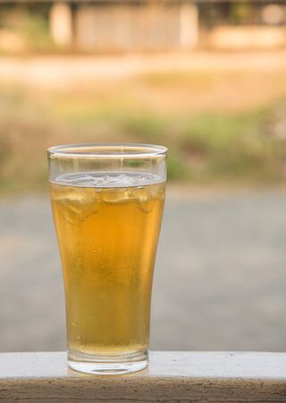 poor light: Beer,Beer glass placed on iron table.background blur and poor light. Stock Photo