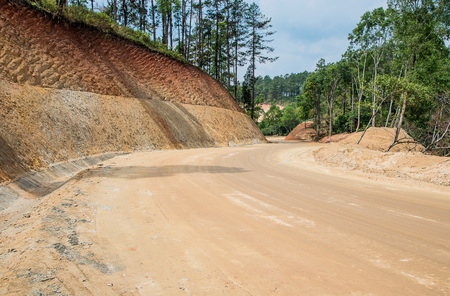 road and path through: Dirt road,New road surface,Road construction path through the forest.Selective focus. Stock Photo