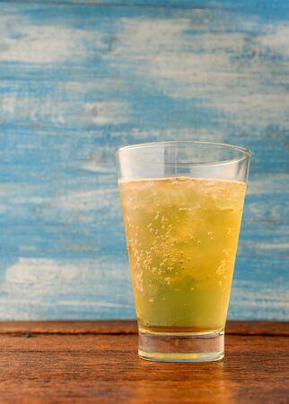 beer bubbles: Beer bubbles in glass on wooden floor,Focus beer glass. Stock Photo