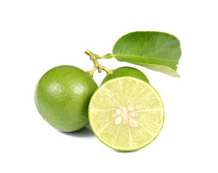 scurvy: Green Lemons , Lemons cut pieces isolated on white background. Stock Photo