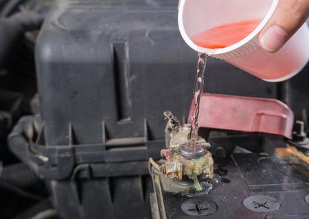 12v: Car battery corrosion on terminal,Dirty battery terminals,Cleaning battery terminals by hot water.