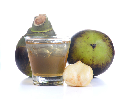 palmyra palm: Toddy Palm,Palmyra palm,Palm juice of glass with ice isolated on white background.