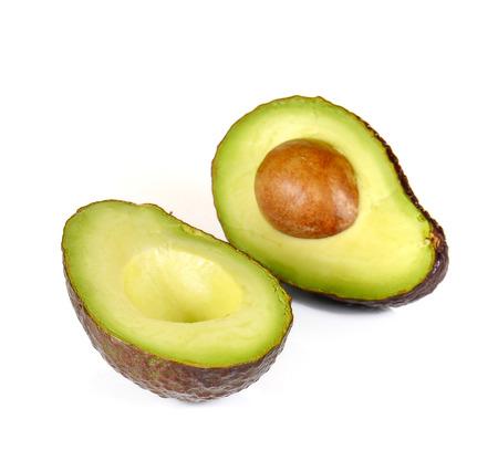Avocado dark brown cut half isolated on white background.