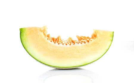 Melon cut pieces isolated on white background.