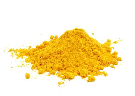 asian flavors: Turmeric powder on white background.