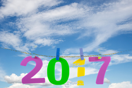 New Year 2017 number on blue sky and white cloud background. Stock Photo